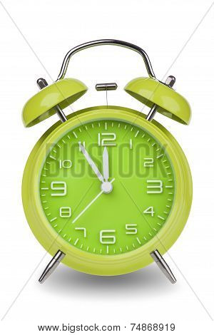 Green Alarm Clock With Hands At 5 Minutes Till 12
