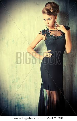 Stunning female model in black evening dress. Fashion shot.