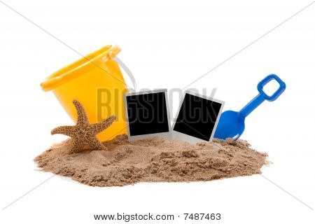 Beach Scene With Flipflops, Sand, Bucket And Starfish