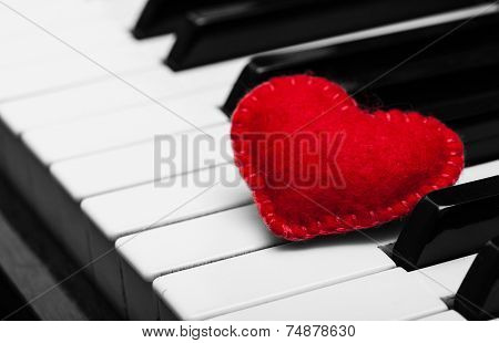 Red Felt Heart On Piano Keyboard