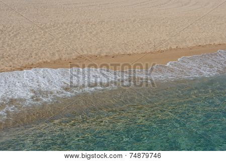 Quiet Sea Wave On The Sandy Beach.