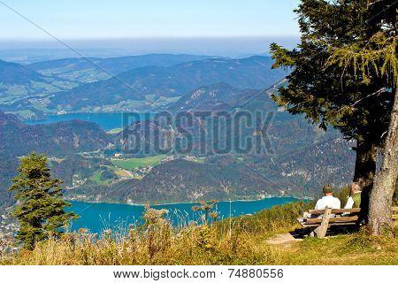 Senior Austrian Couple Looking At Mountain View