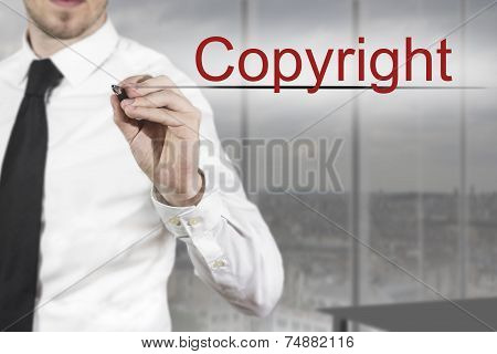 Businessman Writing Copyright In The Air