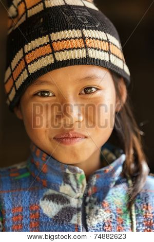 UMPHANG,THAILAND, DECEMBER 01 : Unidentified Burmese little girl portrait in a refugee village near Umphang, North Thailand on December 01, 2012