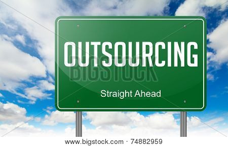 Outsourcing on Green Highway Signpost.