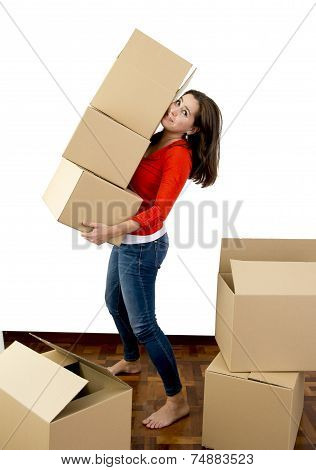 Woman Moving In A New House Carrying Pile Of Cardboard Boxes