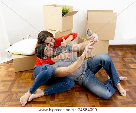 Happy Couple Moving Together In A New House Taking Selfie Video And Pic
