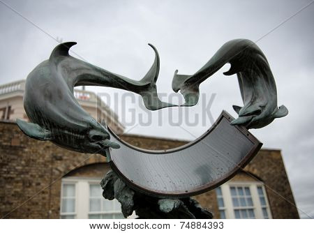 LONDON - April 06: Dolphin Sundial Under Cloudy Skies at Greenwich Royal Observatory, England on April 06, 2014