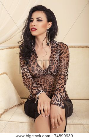 Beautiful Elegant Woman With Dark Hair Posing In Bedroom