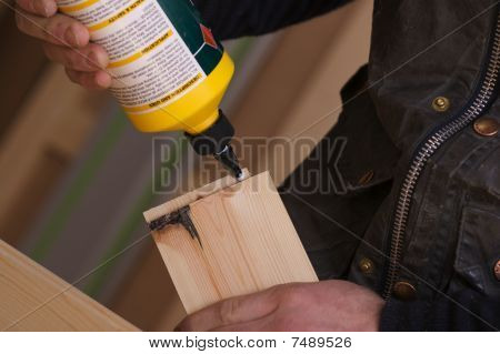 Carpenter Gluing Wooden Pine Frames