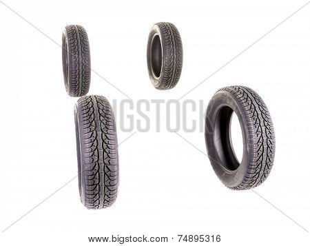 Four winter car tyres shot on white