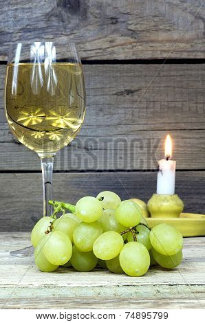 Grape With A Glass Of Wine And Candle