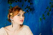 foto of cuff  - Romantic portrait of a beautiful woman with red hair and flowers in her hairstyle - JPG