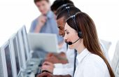 Smiling Business Team Working In A Call Center