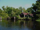 foto of shacks  - A rundown shack on a swamp in Louisiana - JPG