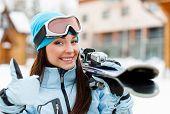 picture of extreme close-up  - Close up of female wearing sports jacket and goggles who hands skis and thumbs up - JPG