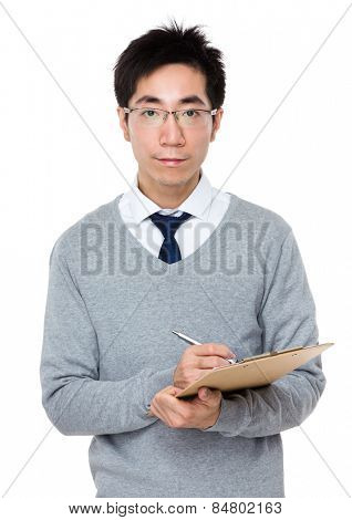 Business man take note on clipboard