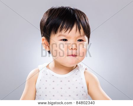 Asian baby with funny facial expression