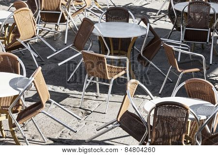 tables and armchairs in a cafe on the street