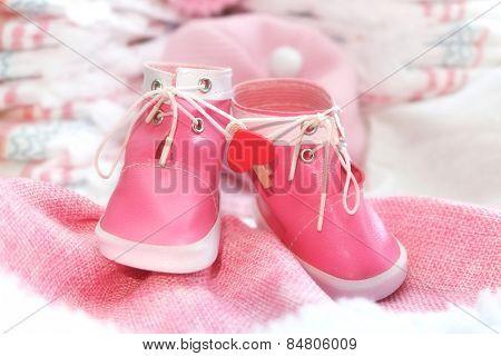 Pink baby girl shoes closeup