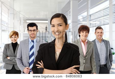 Happy asian businesswoman leading team of business people.