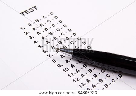 Close Up Of Test Score Sheet Paper With Answers And Pen