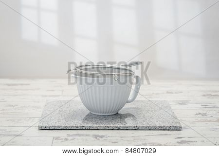 Mixing bowl in the kitchen with metal sieve