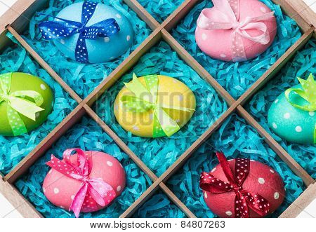 Painted Easter Eggs In A Wooden Box