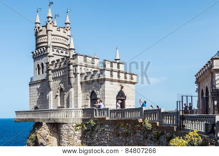 Tourists Walking Near The Castle Swallow's Nest. Swallow's Nest Architectural And Historical Monumen