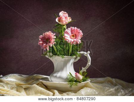 Arrangement of flowers in jug