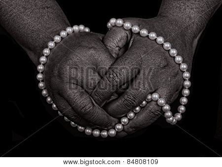 Nice Image of a afro American womans hands with pearls