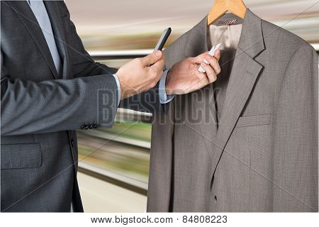 Man Scanning The Price Tag With Mobile Phone