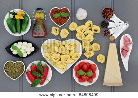 Italian and mediterranean food ingredients over grey background.