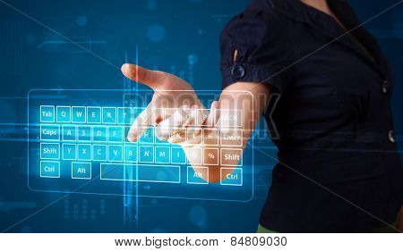 Young girl pressing virtual type of keyboard
