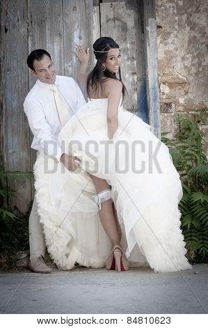 Happy young newly weds outdoors having fun