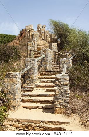 Stairs Leading To A Beach