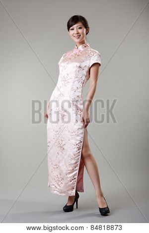 Chinese woman dress n traditional clothes, cheongsam, full length in studio.