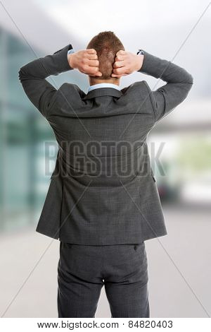 Angry businessman holding his head
