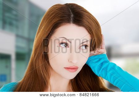 Curious woman overhears a conversation