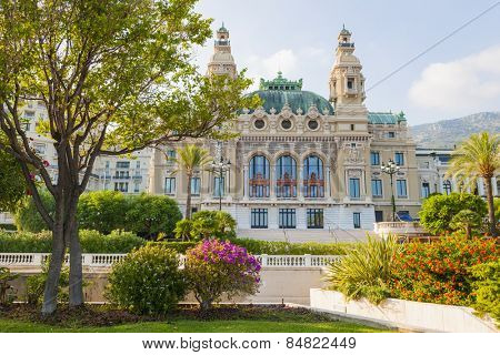 MONTE CARLO, MONACO - OCTOBER 3, 2014: Sea facing facade of Monte Carlo casino in Monaco viewed from gardens at seaside