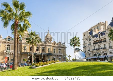 MONTE CARLO, MONACO - OCTOBER 3, 2014: Monte Carlo Casino and Hotel de Paris in Monaco with Sky Mirror sculpture by Anish Kapoor in front