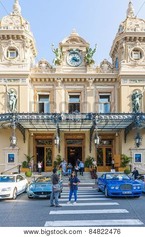 MONTE CARLO, MONACO - OCTOBER 3, 2014: Tourists in from of entrance to Monte Carlo Casino in Monaco