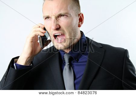 business man screaming on the phone
