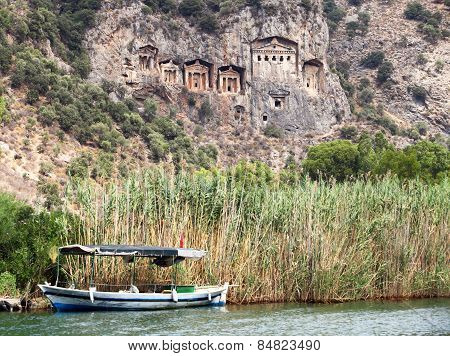 Pleasure Boat With Tourists In The Mouth Of The Dalyan River Under Lycian Tombs