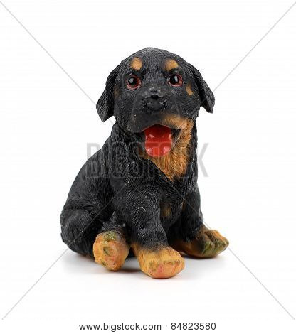 A Small Plastic Toy Doggie Isolated On The White Background