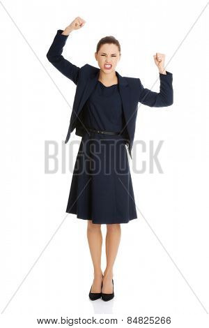 Young angry businesswoman clenching fist