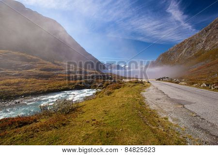 sunny and foggy road in Norway Gamle Strynefjellsvegen