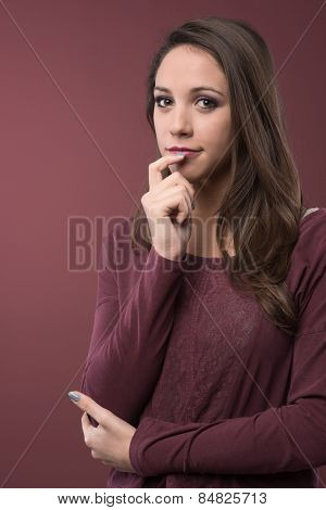 Pensive Woman With Hand On Chin