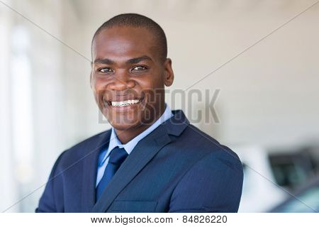 close up portrait of african america businessman at car dealership