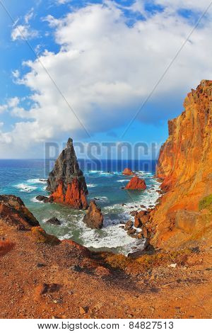 Eastern tip of the island of Madeira in the Atlantic Ocean. Pinnacles covered sunset